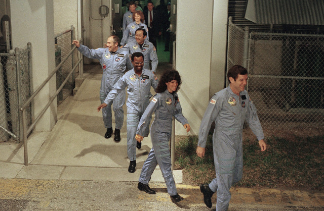 The crew for the Space Shuttle Challenger flight 51-L leaves their quarters for the launch pad, Jan. 27, 1986 at the Kennedy Space Center in Florida. (AP)