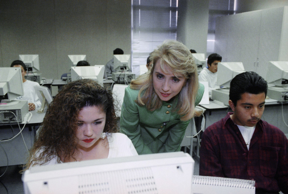 Hillary Clinton, center, visits with students at Century High School in Santa Ana, California in this May 1992 file photo (AP)