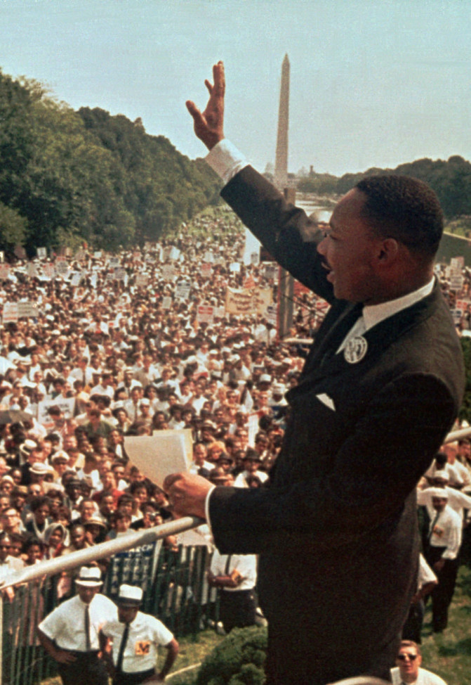 "Dr. Martin Luther King Jr. acknowledges the crowd at the Lincoln Memorial for his ""I Have a Dream"" speech during the March on Washington, D.C. in this file photo of Aug. 28,"