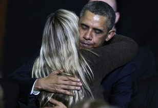 Obama embraces a woman while honoring the families of shooting victims in Hartford, Conn., on April 8, 2013. (AP)