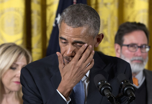 President Barack Obama wipes away tears on Jan. 5, 2016 at the White House, as he recalled the 20 first-graders killed in the 2012 shooting at Sandy Hook school in Conn. (AP)