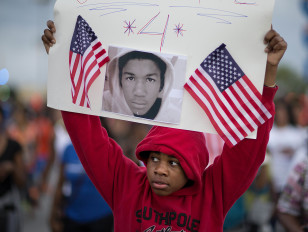 Jaylen Reese protests the  not guilty verdict in the 2012 shooting death of teenager Trayvon Martin on July 15, 2013. (AP)