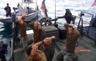 This frame grab from a Jan. 12, 2016 video by the Iranian state-run IRIB News Agency shows the detention of American Navy sailors by the Iranian Revolutionary Guards in the Persian Gulf, Iran. (AP)