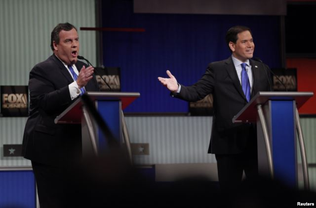 Republican presidential candidates Chris Christie (L) and Marco Rubio speak simultaneously during the Republican presidential debate in North Charleston, S.C., Jan. 14, 2016.
