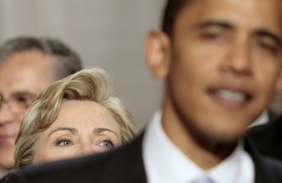 Then Senator Barack Obama stands in front of then Senator Hillary Clinton as they arrive for former President George W. Bush's annual State of the Union address at the U.S. Capitol in Washington January 23, 2007. (Reuters)