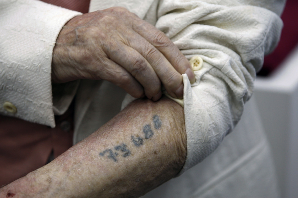 Polish-born Holocaust survivor Meyer Hack shows his prisoner number tattooed on his arm during at the Yad Vashem Holocaust Museum in Jerusalem in this June 2009 file photo. (Reuters)