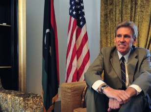 Christopher Stevens, the U.S. ambassador to Libya, smiles at his home in Tripoli June 28, 2012. (AP).