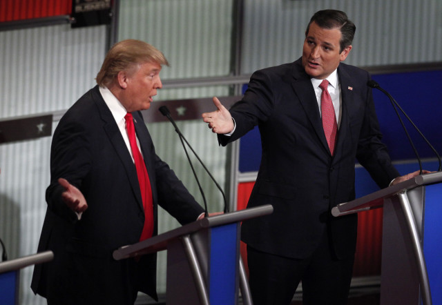 Republican presidential candidates Donald Trump (L) and Ted Cruz speak simultaneously during the Republican presidential debate in North Charleston, SC, Jan. 14, 2016. Reuters