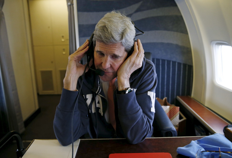 "Secretary of State John Kerry communicates from aboard his plane on his way to Vienna, Austria on ""implementation day,"" the day the International Atomic Energy Agency verifies that Iran has met all conditions under the nuclear deal, Jan. 16, 2016.  (Reuters)"