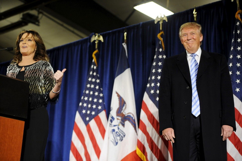 Former Alaska Gov. Sarah Palin (L) points to Republican presidential candidate Donald Trump (R) as she speaks after endorsing him for President at a rally in Ames, Iowa Jan. 19, 2016. REUTERS