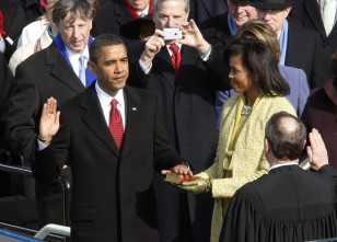 Barack Obama takes the Oath of Office as the 44th president of the United States with Chief Justice John Roberts and his wife, Michelle, on Jan. 20, 2009. (Reuters)