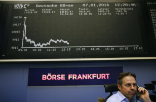 A trader speaks on a phone in front of the German share price index DAX board at  the stock exchange in Frankfurt on Jan. 7, 2016 (Reuters)