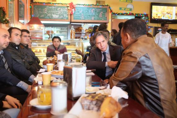 Deputy Secretary Antony Blinken meets with recently resettled refugees in a Northern Virginia coffee shop in Dec. 2015. (State Department photo)