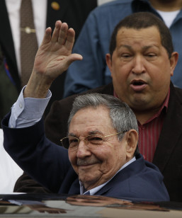 Cuba's President Raul Castro, front, waves after a summit in Caracas, Venezuela on Feb. 5, 2012. Behind Castro is Venezuela's President Hugo Chavez.(AP)