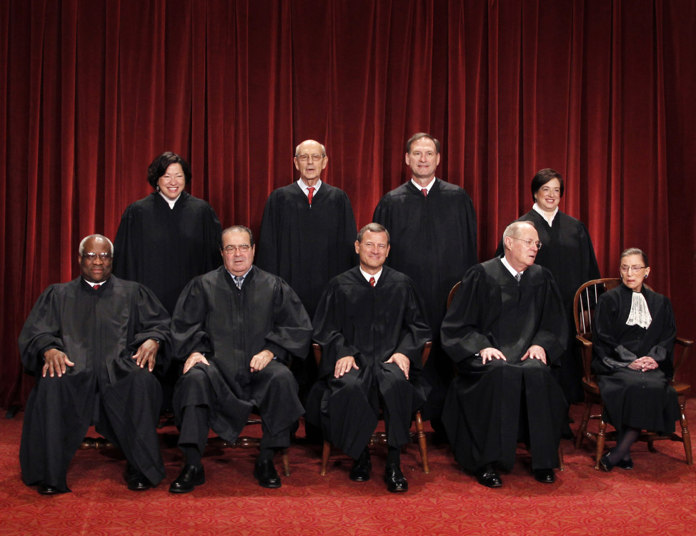 The Supreme Court justices pose for a group photo at the Supreme Court in Washington in 2008.. (AP/file)