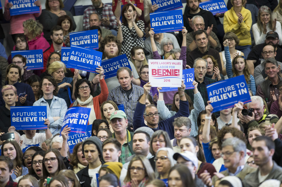 Supporters hold signs as Democratic presidential candidate Sen. Bernie Sanders, I-Vt., speaks during a campaign stop in Portsmouth, N.H. on Feb. 7, 2016. (AP)