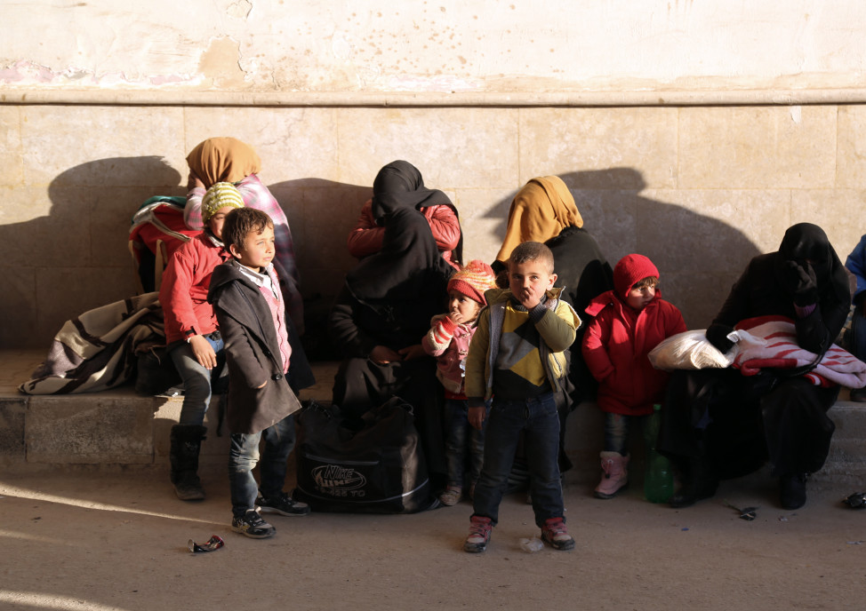 Syrians fleeing the conflicts in Azaz region, wait at the Bab al-Salam border gate in Syria on Feb. 5, 2016. (AP)