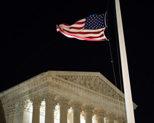 A U.S. flag flies at half-staff in front of the U.S. Supreme Court in Washington on Feb. 13, 2016 after news of the death of  Supreme Court Justice Antonin Scalia at 79. (AP)