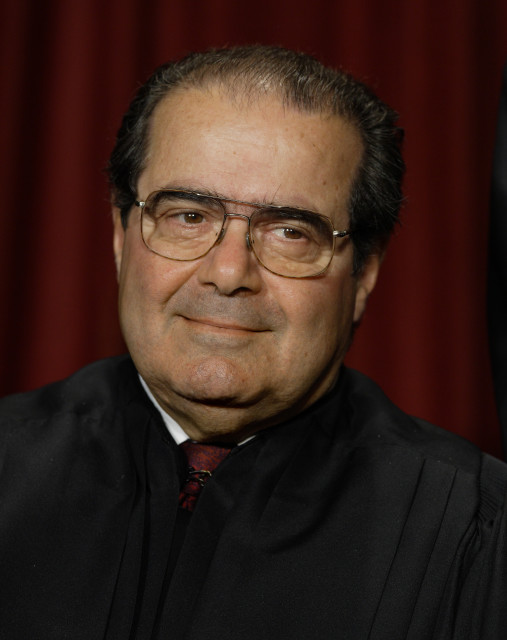 FILE - In this Monday, Oct. 31, 2005 file photo, Associate Justice Antonin Scalia joins the members of the Supreme Court for photos during a group portrait session, at the Supreme Court Building in Washington. AP