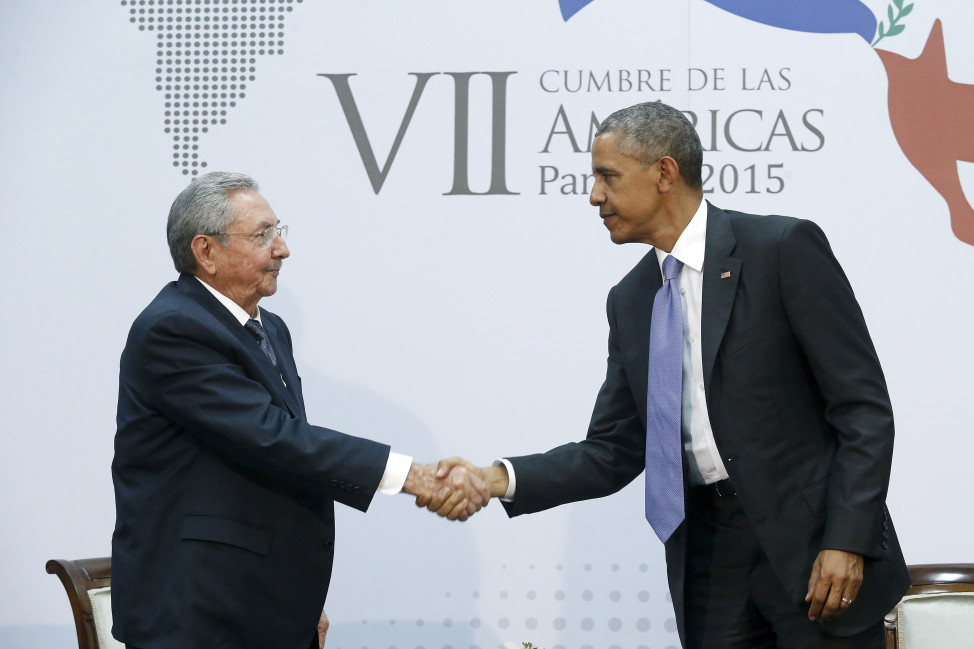 Obama shakes hands with Castro as they hold a bilateral meeting during the Summit of the Americas in Panama City