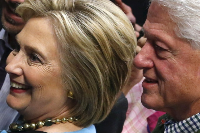 Democratic presidential candidate Hillary Clinton and former President Bill Clinton are seen during a campaign stop in Manchester, NH  Feb. 8, 2016. (Reuters)