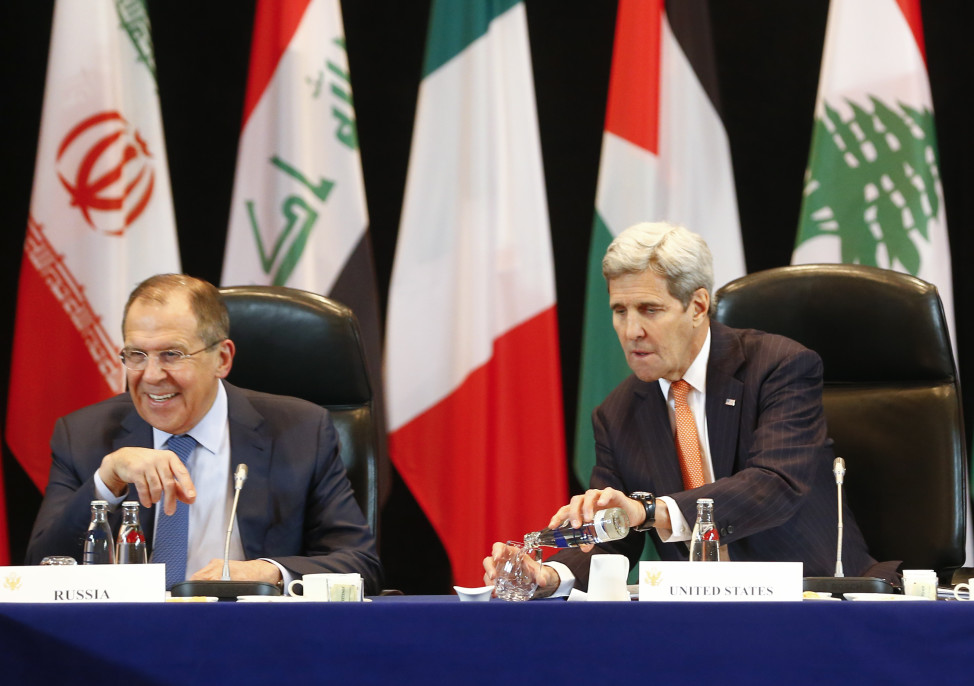 U.S. Secretary of State  John Kerry and Russian Foreign Minister Sergei Lavrov (L) attend the International Syria Support Group (ISSG) meeting in Munich, Germany, February 11, 2016, together with members of the Syrian opposition and other officials. REUTERS