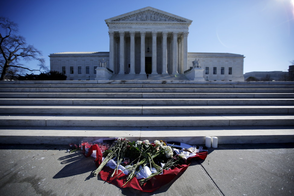 Flowers placed in front of the Supreme Court building in Washington D.C. a day after the death of U.S. Supreme Court Justice Antonin Scalia on Feb. 14, 2016. (Reuters)