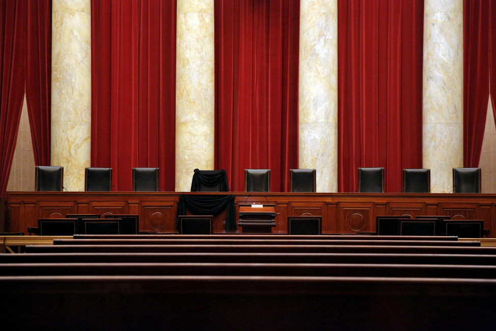 Black wool crepe adorns the bench of the late Justice Antonin Scalia inside the Supreme Court in Washington Feb. 16, 2016. REUTERS