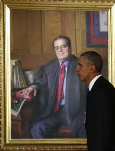 President Obama walks past a portrait of U.S. Supreme Court Justice Antonin Scalia after paying his respects at his casket in the U.S Supreme Court Feb. 19, 2016. REUTERS