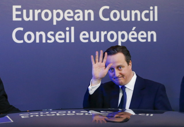 """British Prime Minister David Cameron waves as he leaves a European Union leaders' summit in Brussels Feb. 20, 2016. Cameron said on Friday he would campaign with all his """"heart and soul"""" for Britain to stay in the European Union after he won a deal about  the so-called Brexit, in Brussels which offered his country """"special status"""".  (Reuters)"""
