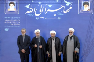 Iranian President Hassan Rouhani (2nd L) speaks as parliament speaker Ali Larijani ( L), Judiciary Chief Ayatollah Sadeq Larijani (2nd R), and the chief of the supreme leader's office Mohammad Golpayegani attend a ceremony in Tehran on Oct. 3, 2015. (Reuters)