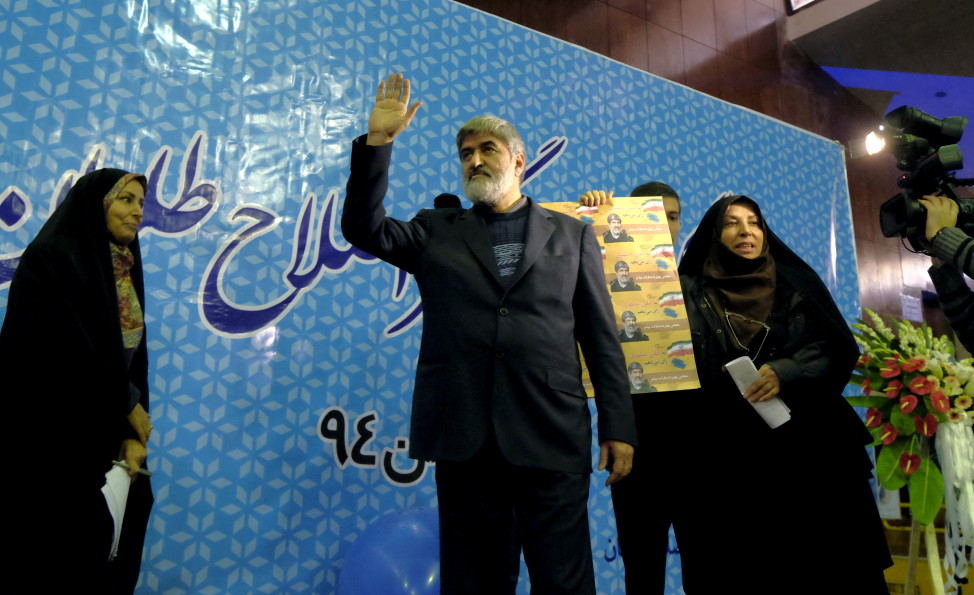 Iranian lawmaker Ali Motahari waves to supporters in Tehran during a rally for parliamentary elections on Feb. 18, 2016. (Reuters)