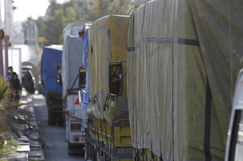 A convoy carrying humanitarian goods wait to enter the besieged area of Moudamiya Al Sham in the suburbs of Damascus, Syria on Feb. 17, 2016. (Reuters)