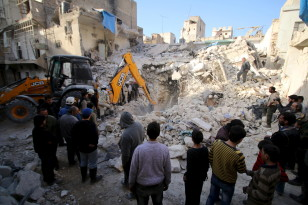 Local officials search for survivors after airstrikes by pro-Syrian government forces in the rebel held al-Qaterji neighborhood of Aleppo on Feb. 14, 2016. (Reuters)