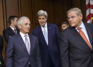 Secretary of State John Kerry, center, is flanked by Senate Foreign Relations Chairman Robert Menendez, D-N.J., right, and Sen. Bob Corker, R-Tenn., the ranking member, left, on Capitol Hill in Washington, Sept. 17, 2014. (AP)