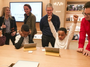 Apple Chief Executive Officer Tim Cook (C) attends an event for students to learn to write computer code at the Apple store in New York City on Dec. 9, 2015. (Reuters)