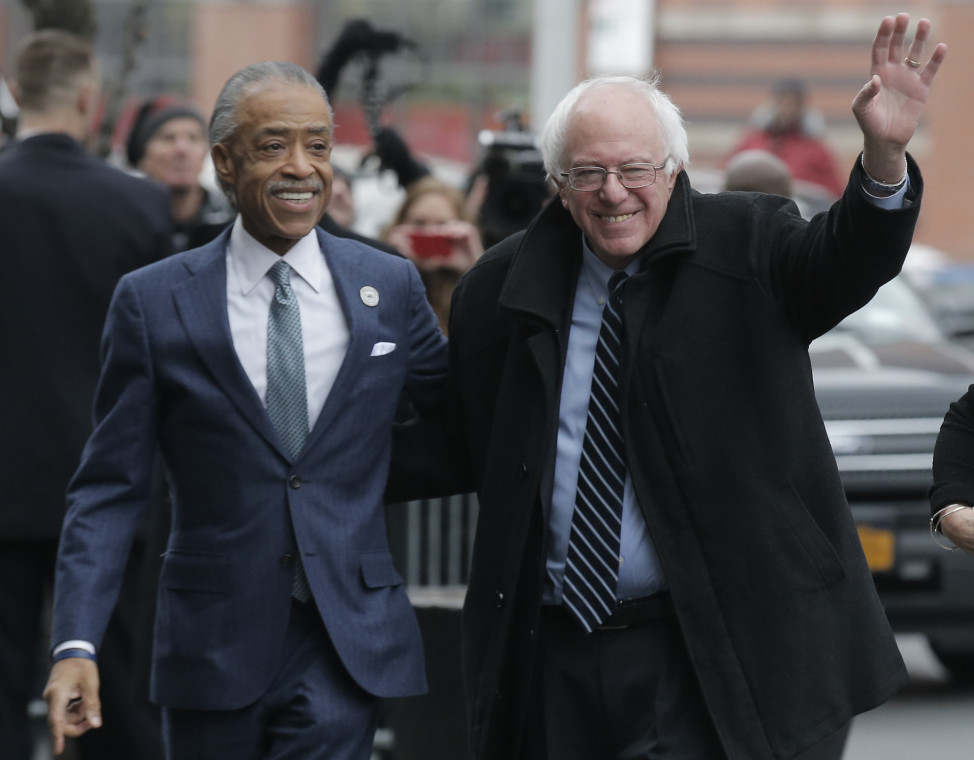 Democratic presidential candidate Bernie Sanders (R) is greeted by the Rev. Al Sharpton in the Harlem section of New York a day after winning the New Hampshire primary. (Reuters)