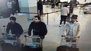 Photo released by Belgian federal police on demand of Federal prosecutor shows screengrab of airport CCTV camera showing suspects of this morning's attacks at Brussels Airport, in Zaventem, March 22, 2016. (AFP)