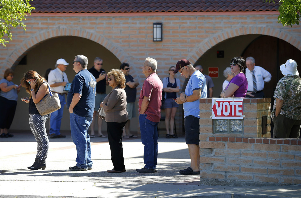 Voters wait in a long line to cast their ballot in Arizona's presidential primary on March 22, 2016 in Gilbert, Ariz. (AP)