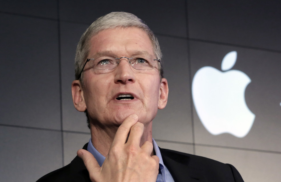 In this April 30, 2015, file photo, Apple CEO Tim Cook responds to a reporter in New York City. (AP)