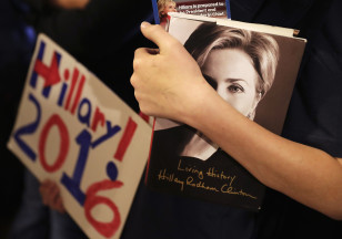 A supporter hold a copy of Hillary Clinton's book while waiting to enter a campaign event on Feb. 26, 2016 in Atlanta. (AP)