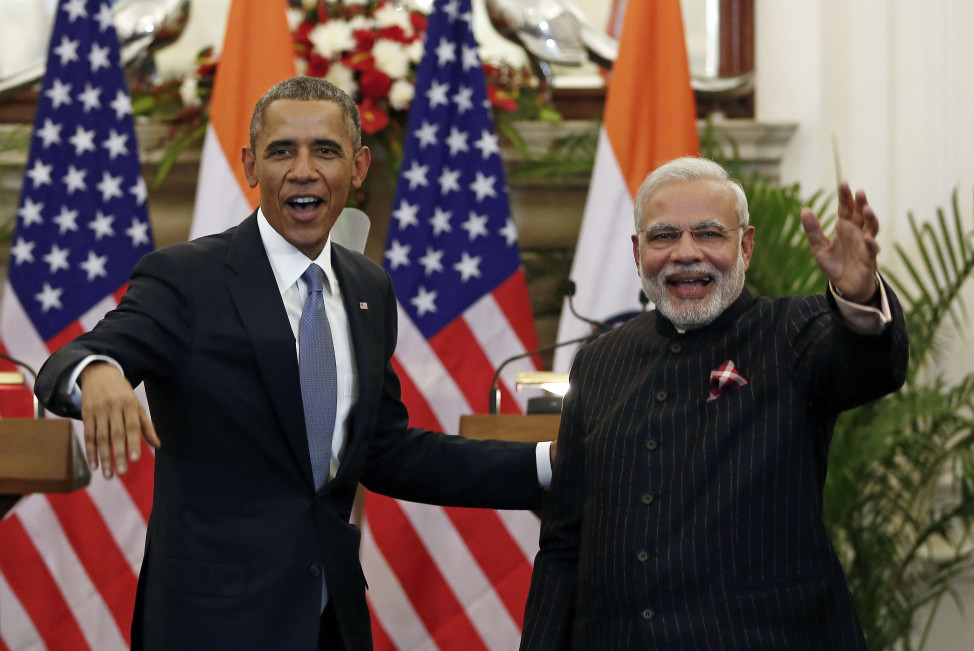 President Barack Obama stands next to Indian Prime Minister Narendra Modi as they leave after giving their opening statement in New Delhi on Jan. 25, 2015. Obama and Modi announced a breakthrough on nuclear trade that both sides hope will help establish an enduring strategic partnership. (Reuters)