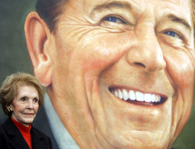Former first lady Nancy Reagan stands nex to to an image of the President Ronald Reagan commemorative postage stamp during a ceremony at the Ronald Reagan Presidential Library and Museum November 9, 2004 in Simi Valley, California.  (Reuters)
