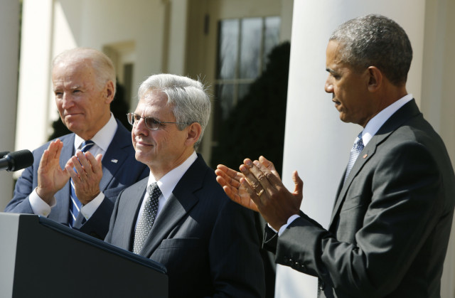 U.S. President Barack Obama applauds Judge Merrick Garland (C) of the United States Court of Appeals as his nominee for the U.S. Supreme Court as Vice President Joe Biden (L) joins in at the Rose Garden of the White House in Washington March 16, 2016.        REUTERS