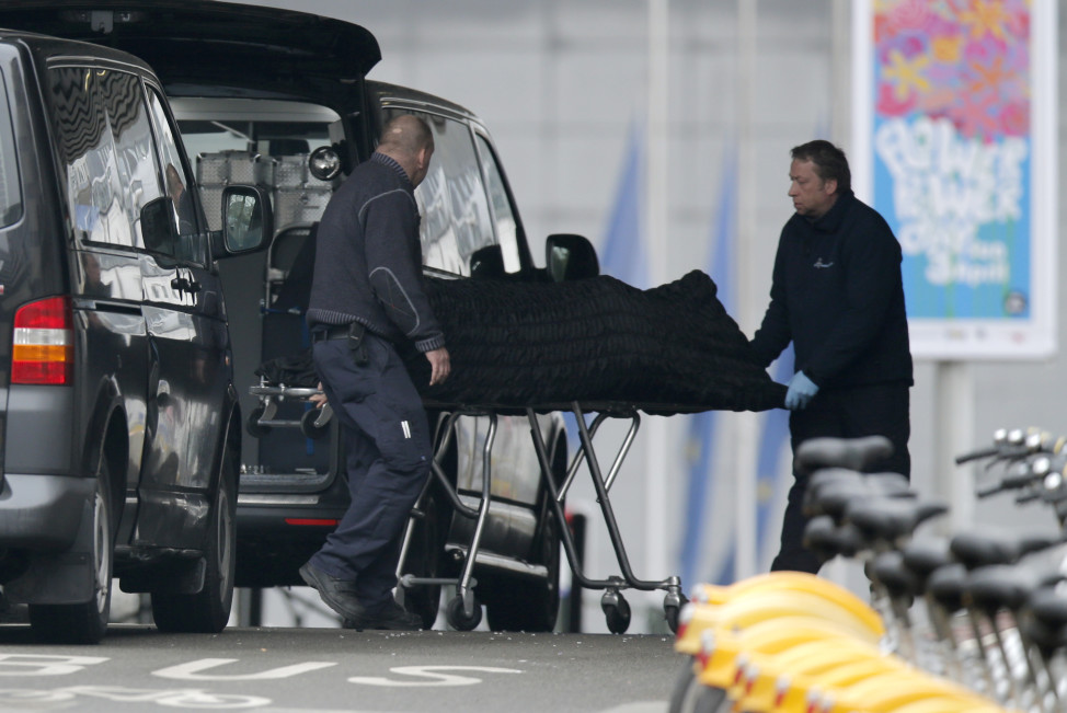 Funeral workers remove victims from the Maalbeek subway station last week's  attacks in Brussels on March 23, 2016.  (Reuters)