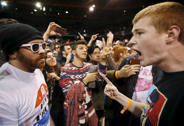 A Trump supporter (R) yells at a demonstrator (L) after Republican U.S. presidential candidate Donald Trump cancelled his rally at the University of Illinois at Chicago March 11, 2016. (Reuters)