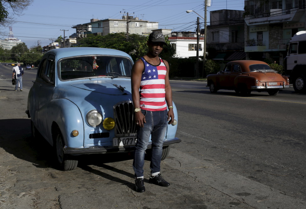 Yosuan, 26, wearing a shirt emblazoned with the American flag, stands on a street in Havana, Cuba on Feb. 22, 2016. (Reuters)