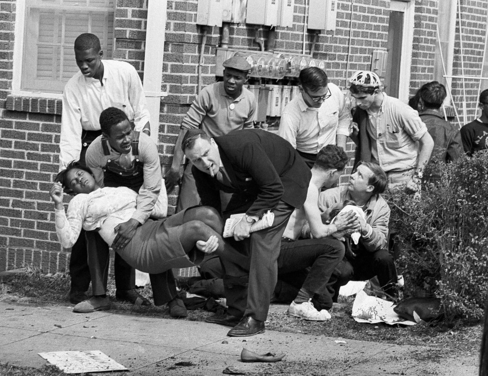 "Amelia Boynton is carried and another injured man tended to after they were injured when state police broke up a demonstration march in Selma, Ala. Boynton, wife of a real estate and insurance man, has been a leader in civil rights efforts. The day, which became known as ""Bloody Sunday,"" is widely credited for galvanizing the nation's leaders and ultimately yielded passage of the Voting Rights Act of 1965. (AP)"