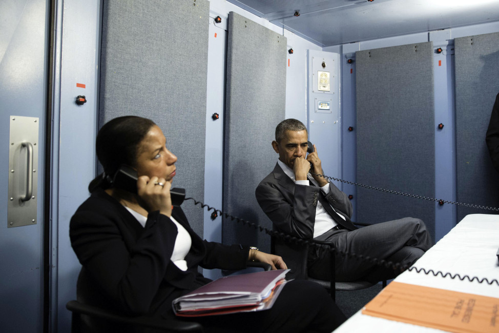 President Barack Obama and National Security Adviser Susan E. Rice (L) talk to Homeland Security for updates on the terrorist attack in Brussels, Belgium, in this official White House handout photo taken in Havana, Cuba on March 22, 2016. (Reuters)