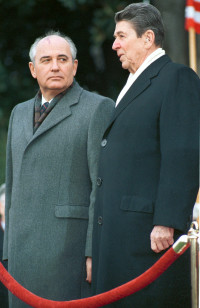 President Ronald Reagan (R) stands with then Soviet President Mikhail Gorbachev at the White House in this Dec. 8, 1987. file photo. (Reuters)